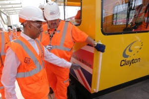 London Mayor Sadiq Khan boarding a Clayton Equipment CD40 locomotive as Crossrail's first passenger